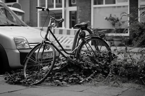 Grayscale Photo of Bicycle on the Road