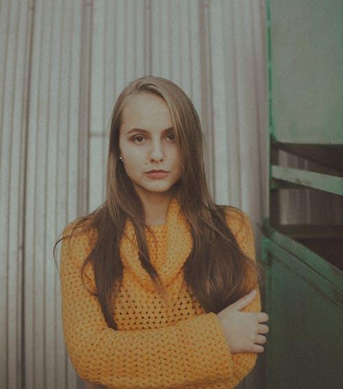 Woman in Yellow Knitwear
