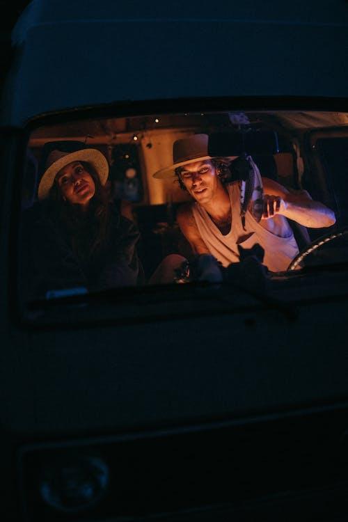A Man and a Woman Inside a Car