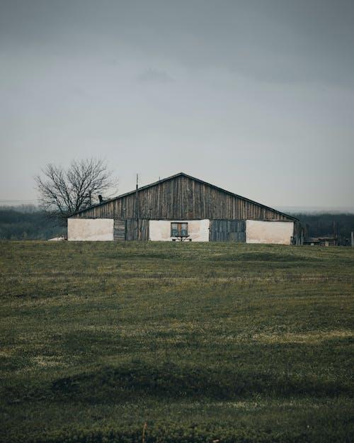 Barn House on Grass Field