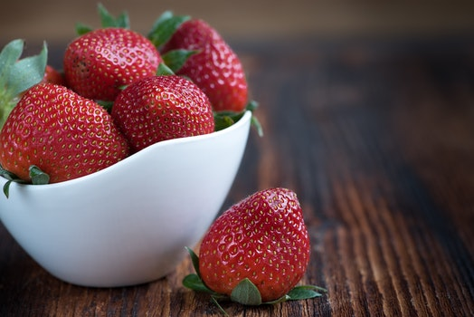 White Bowl of Whole Strawberries