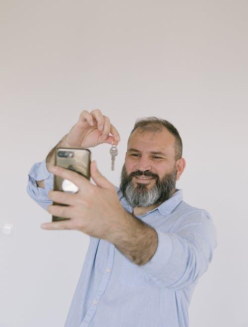 Fotos de stock gratuitas de barba, hombre, llave