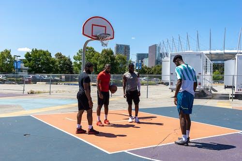 People Practicing Basketball