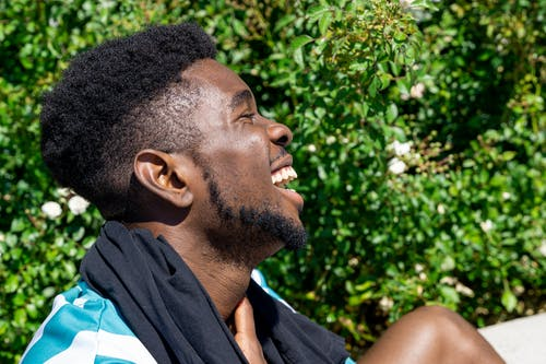 Side Profile of a Laughing Man