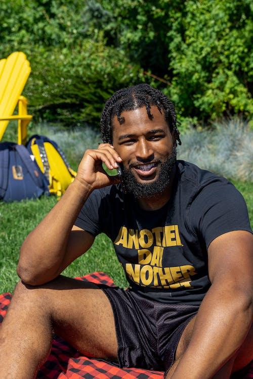 Man in Black Shirt Having a Phone Call