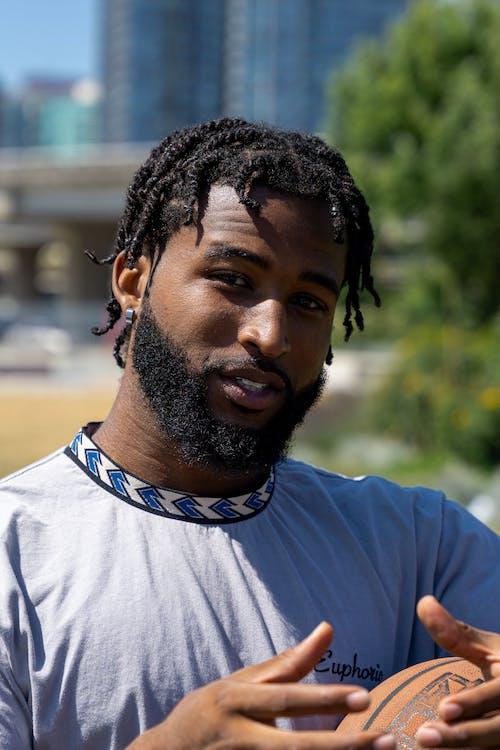 Bearded Man in Gray Shirt Looking at Camera
