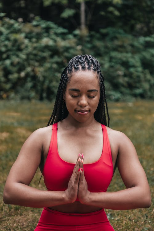 Woman in Red Activewear Meditating