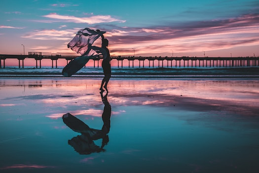Woman Standing on Shallow Water
