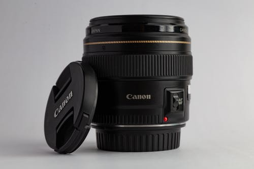 Close-Up Photo of Black Canon Dslr Camera Lens