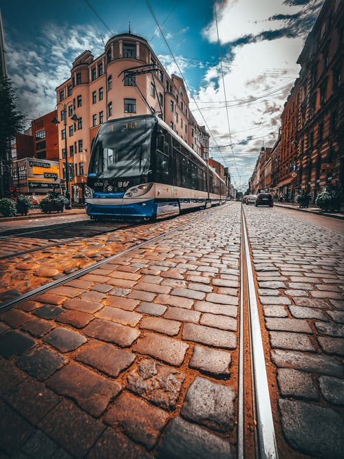 Blue and White Tram on Road
