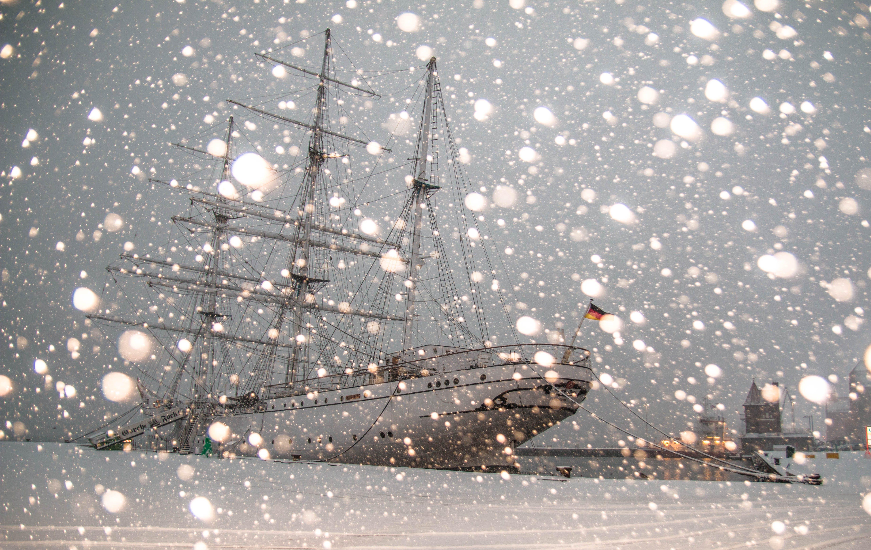 White Sailing Ship Docked at Pier