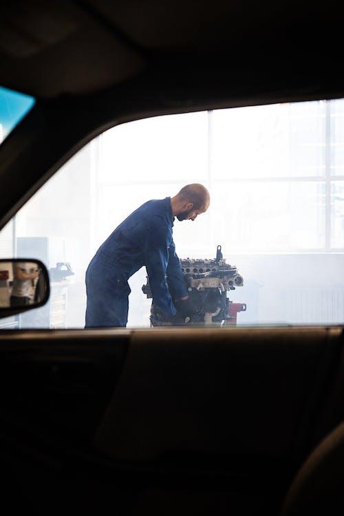A Mechanic Working on an Engine