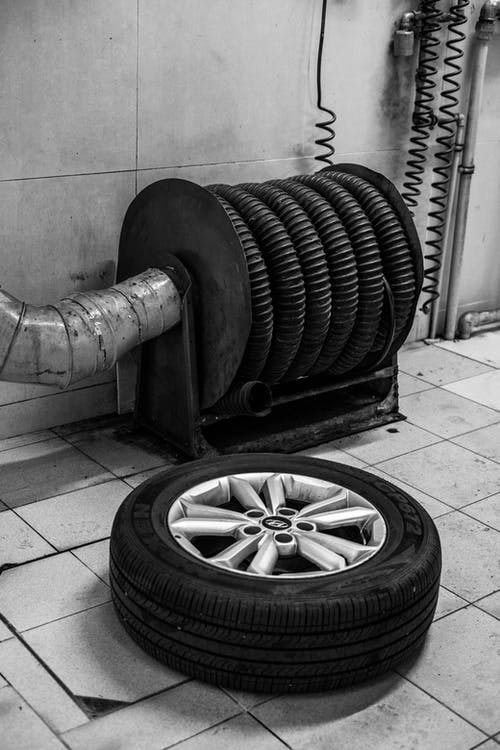 Grayscale Photo of a Car Tire