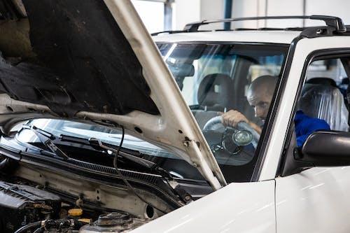 White Car With Open Door
