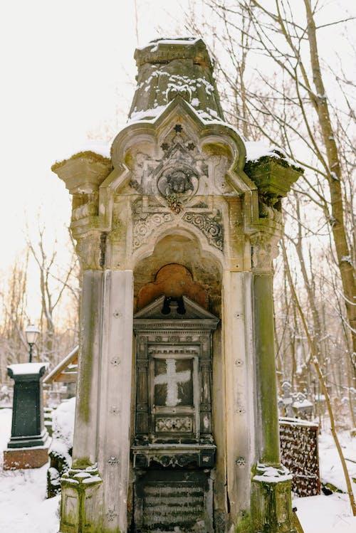 An Old Concrete Cast Gravestone in a Cemetery