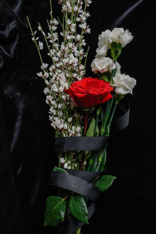 A Flower Bouquet Wrapped in Black Ribbon
