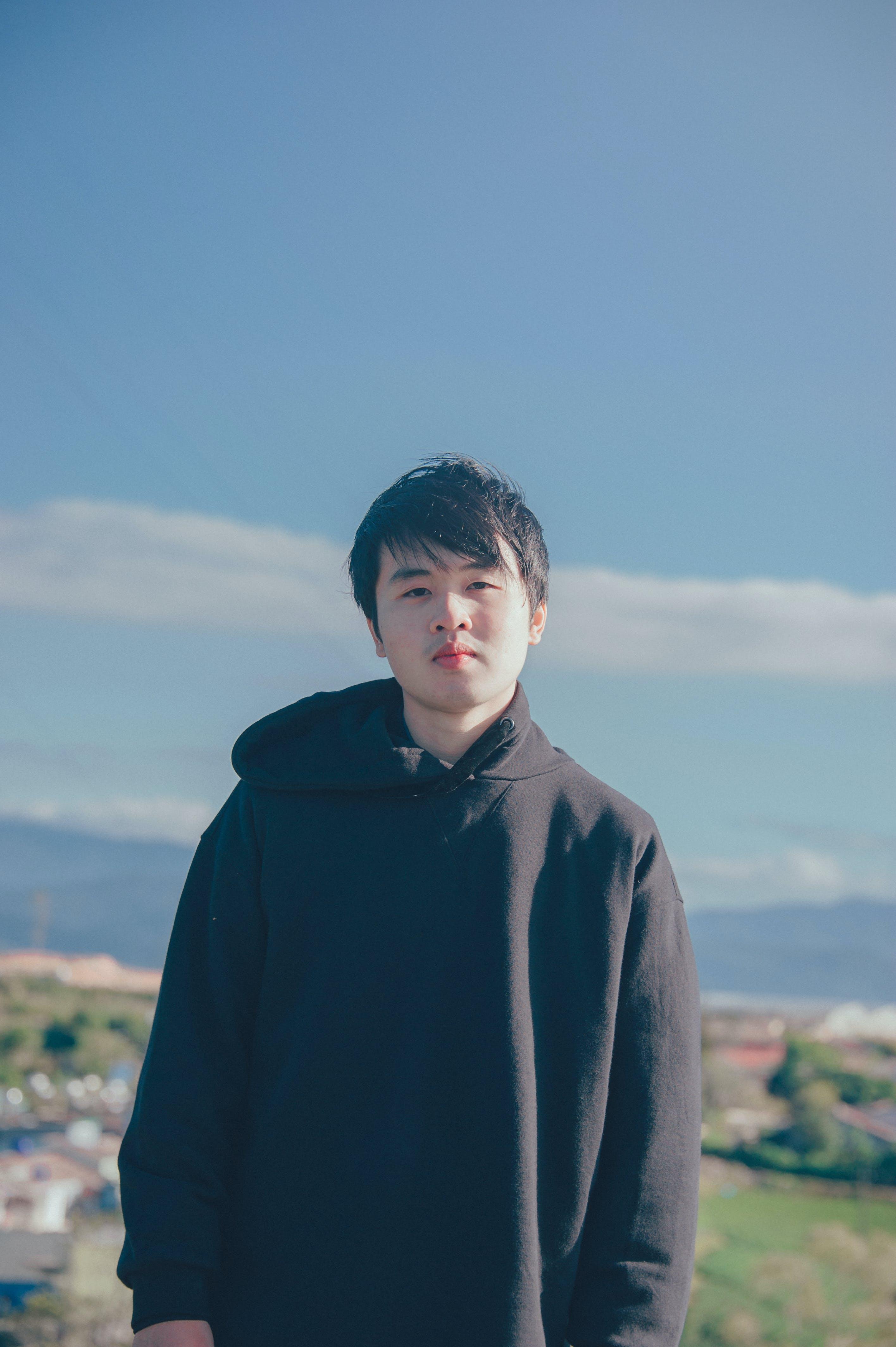Man Wearing Black Pullover Hoodie