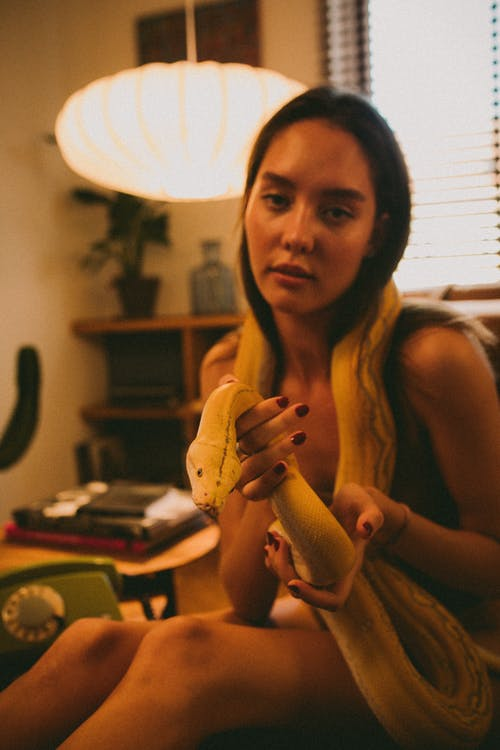 A Woman Holding a Live Snake