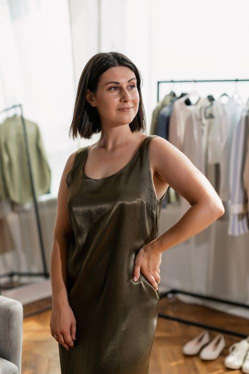 A Posing Woman Wearing a Sleeveless Dress