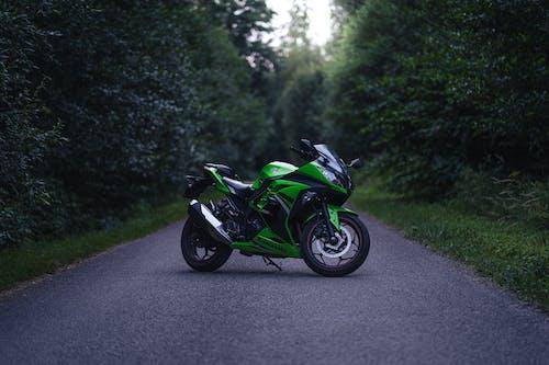 Green and Black Sports Bike on Road