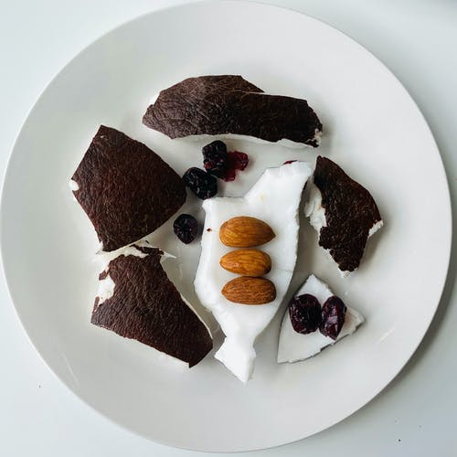 Coconut Meat with Nuts and Raisins on a Plate