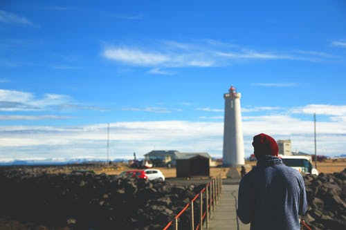 Free stock photo of hiker, iceland, lighthouse
