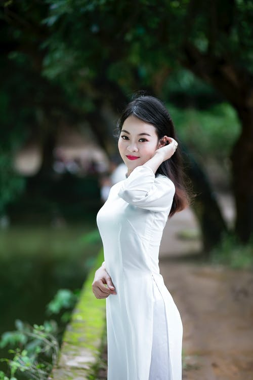 Woman Wearing White 3/4-sleeved Dress