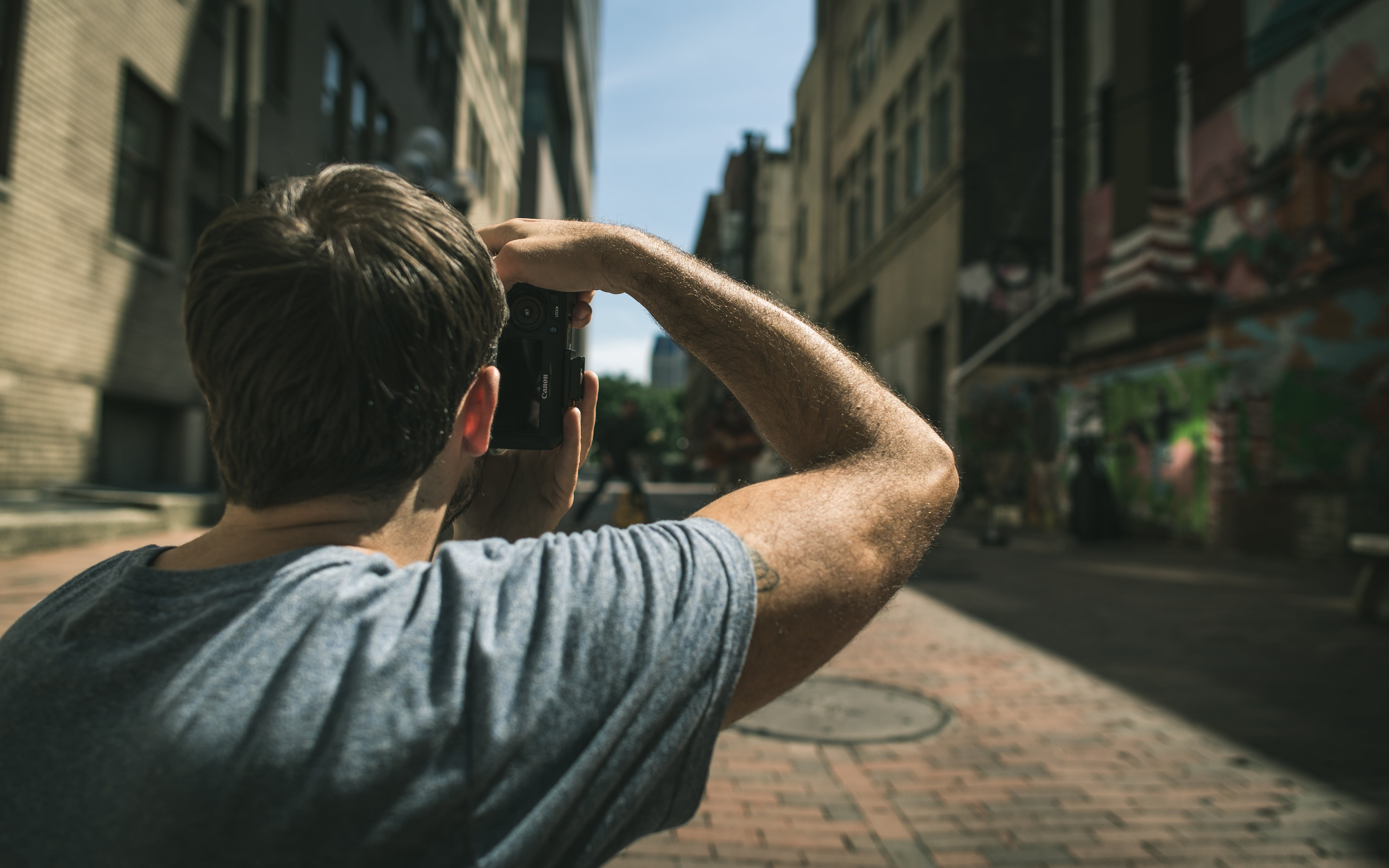 Man Taking Photo of Buildings