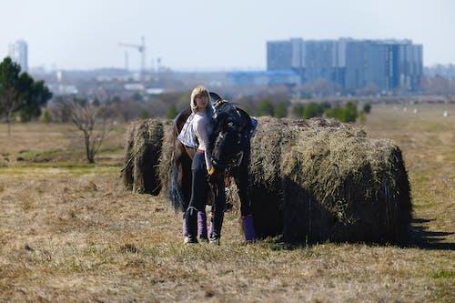 Woman in Black Jacket Standing on Brown Grass Field