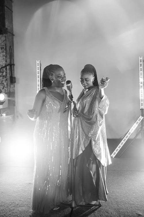 Grayscale Photo of Women Singing