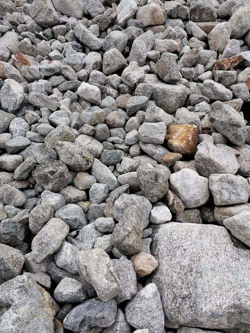 Close-Up Photo of a Pile of Rough Stones