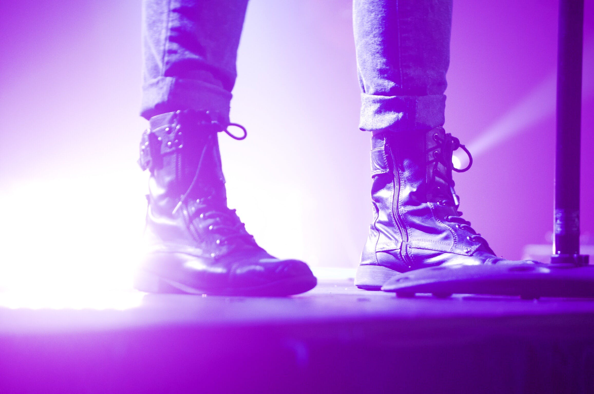 Person Wearing Lace Up Boots Standing on Stage