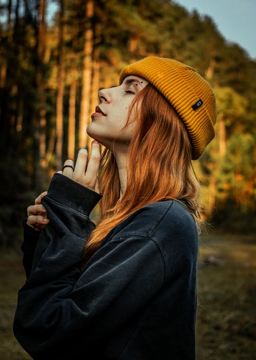 Woman in Black Coat and Yellow Knit Cap