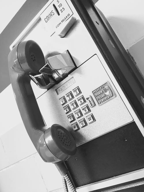 Gray and Black Coin Operated Telephone