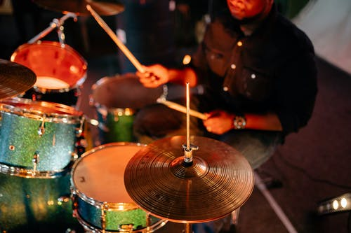 Man in Black Shirt Playing Drum
