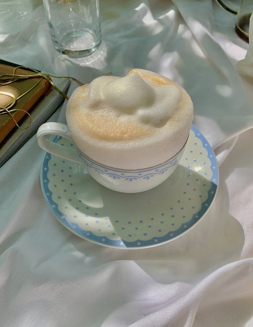 Ceramic Cup with Saucer Full of Coffee Foam