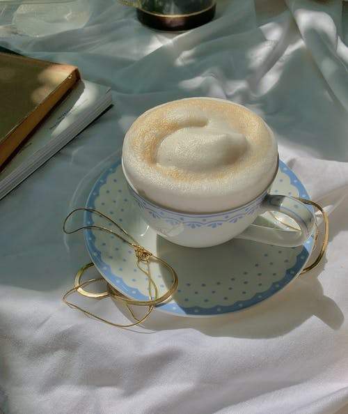 White Coffee Cup on White Saucer