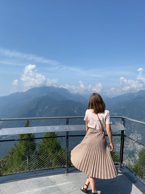 Woman Looking at Mountain Ranges