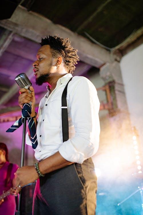 Man in White Dress Shirt Singing