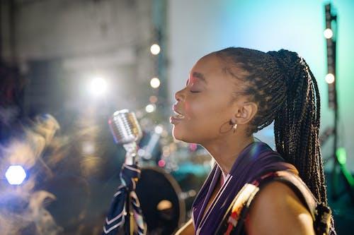 A Close-Up Shot of a Woman Singing