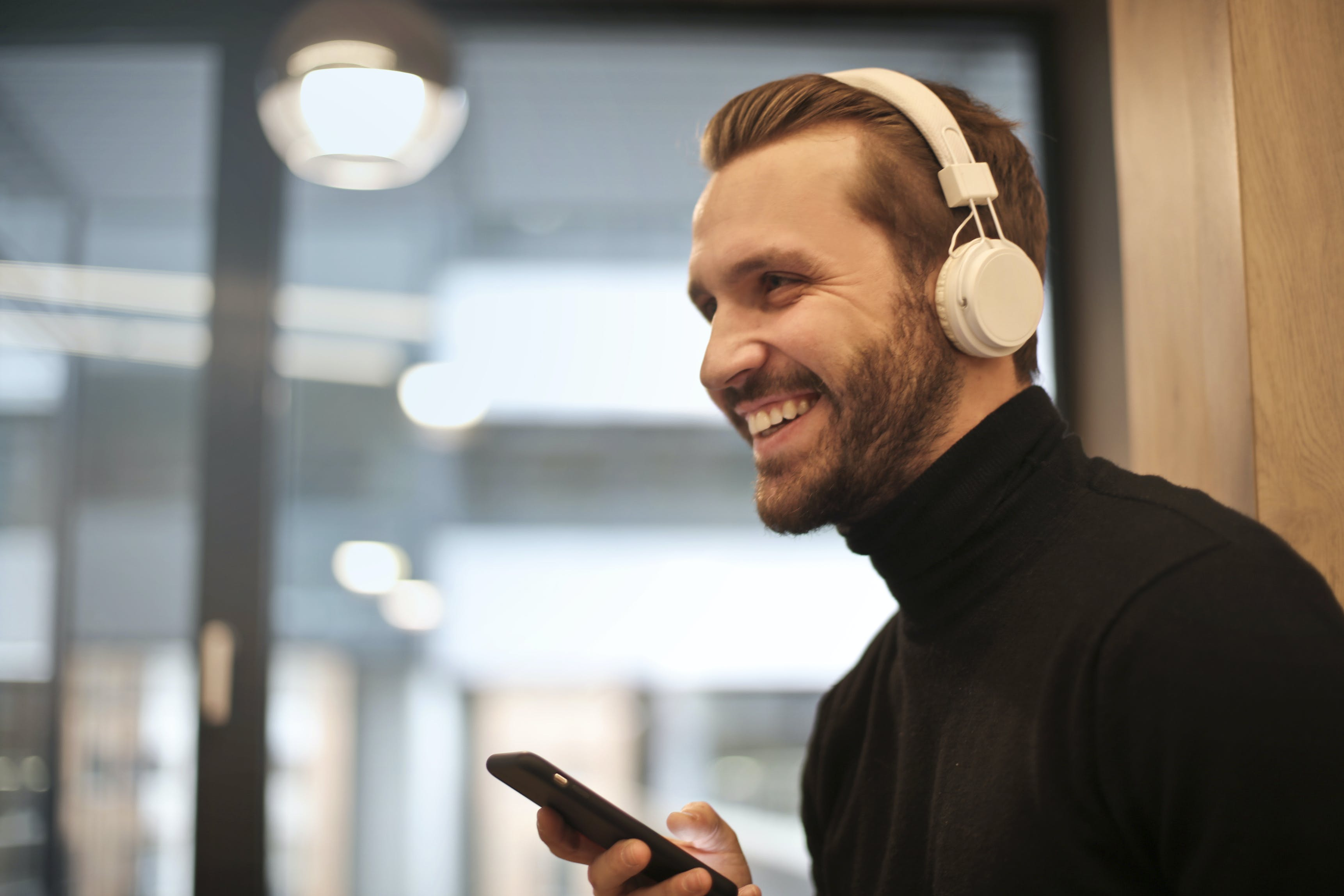 Man Wearing White Headphones Listening to Music