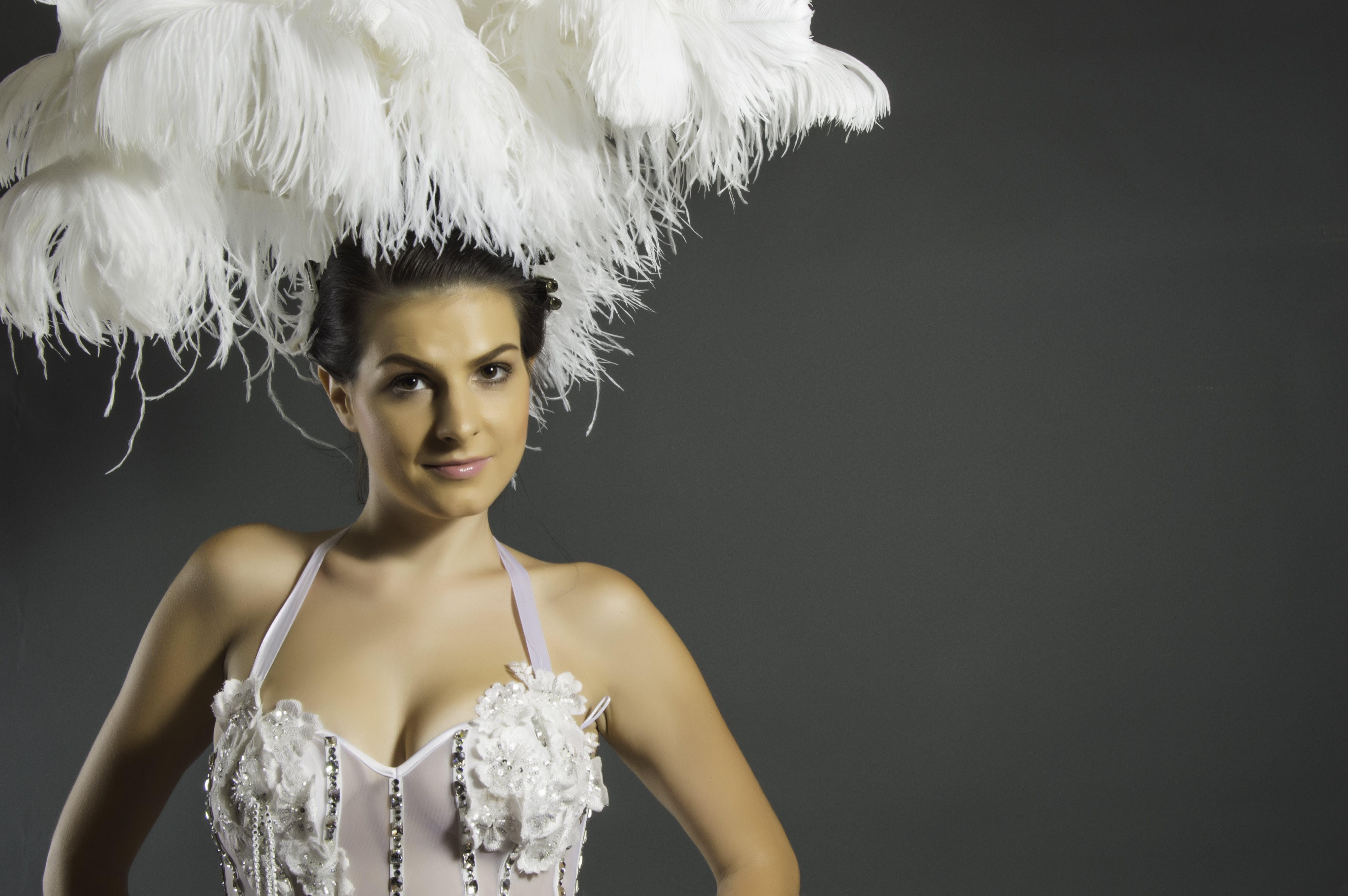 Woman With White Sleeveless Dress