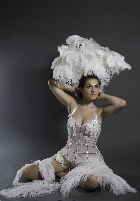 Woman Sitting White Holding Hair Photo
