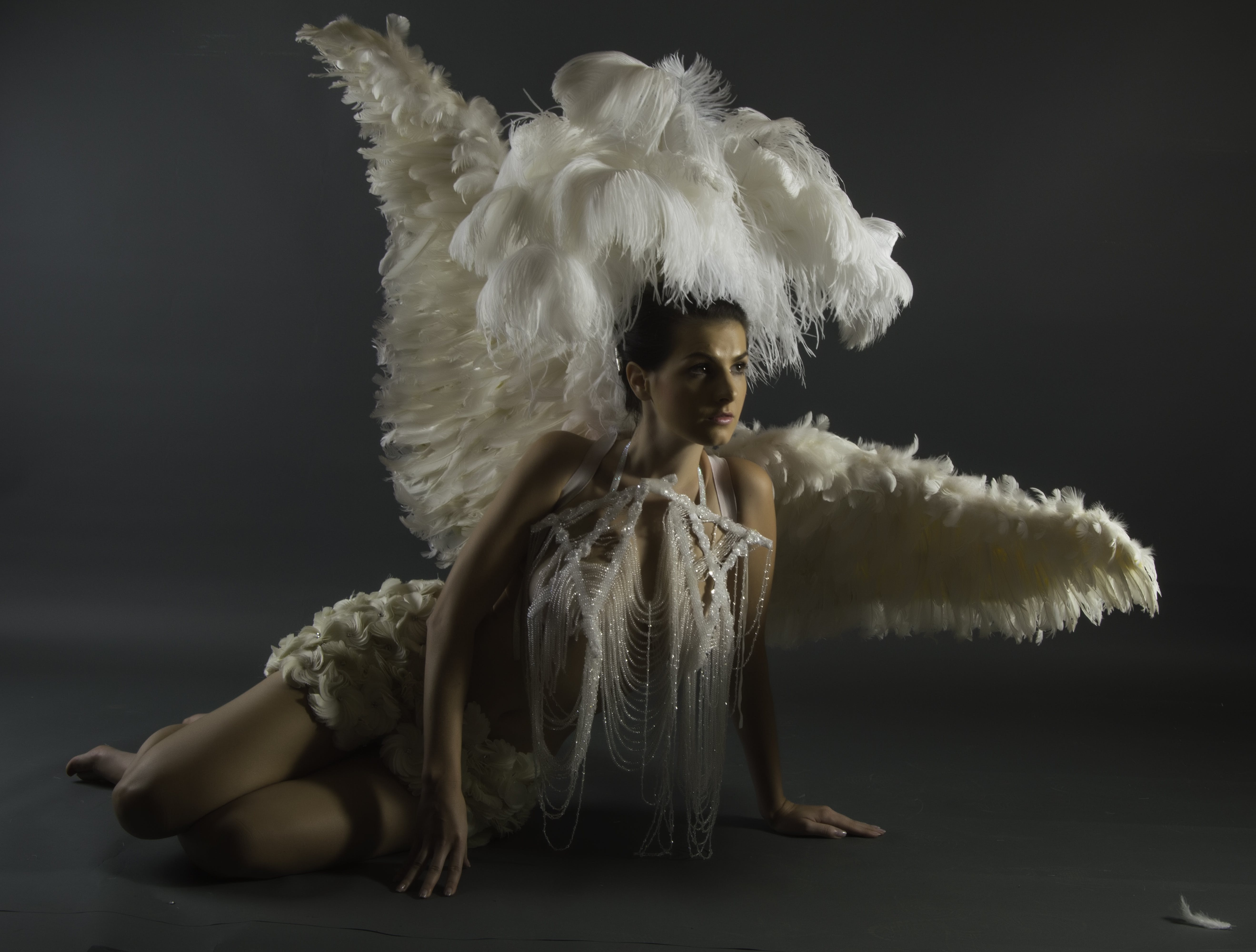 Woman in White Wings With Headdress