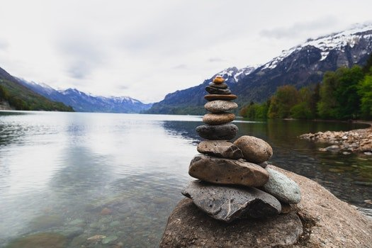 Brown and Gray Stone Stack Near Body of Water