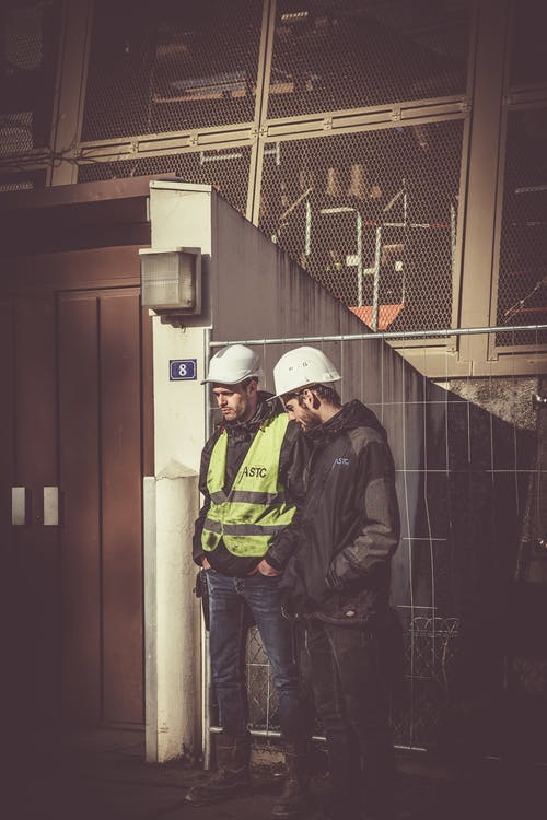 Two Men Wearing White Hard Hat