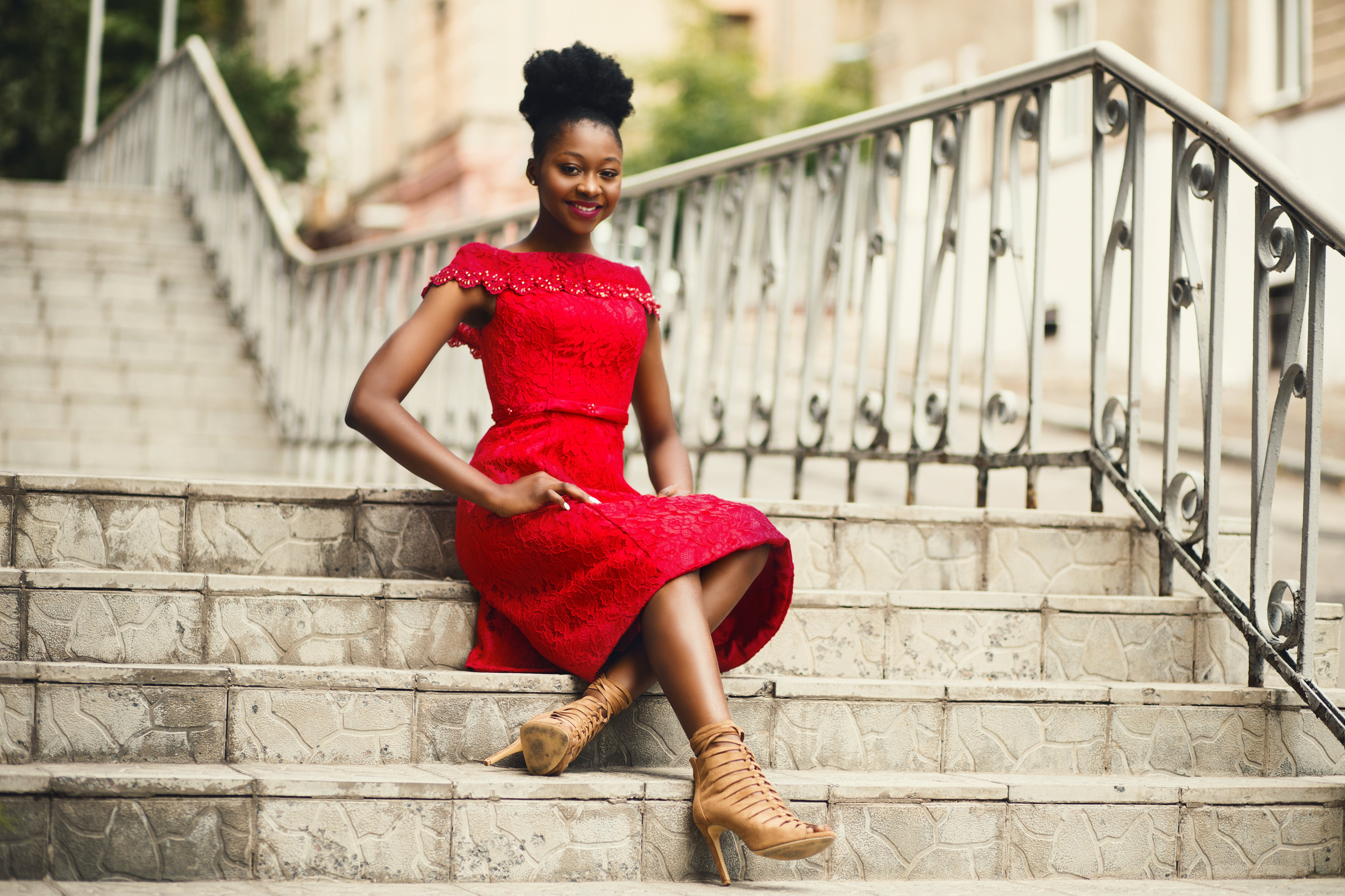 Woman in Red Off-shoulder Dress With Brown Leather High Heeled Gladiator Sandals on Brown Stairs