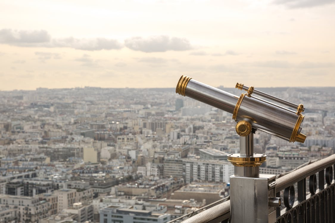 Gray and Gold Telescope on Building