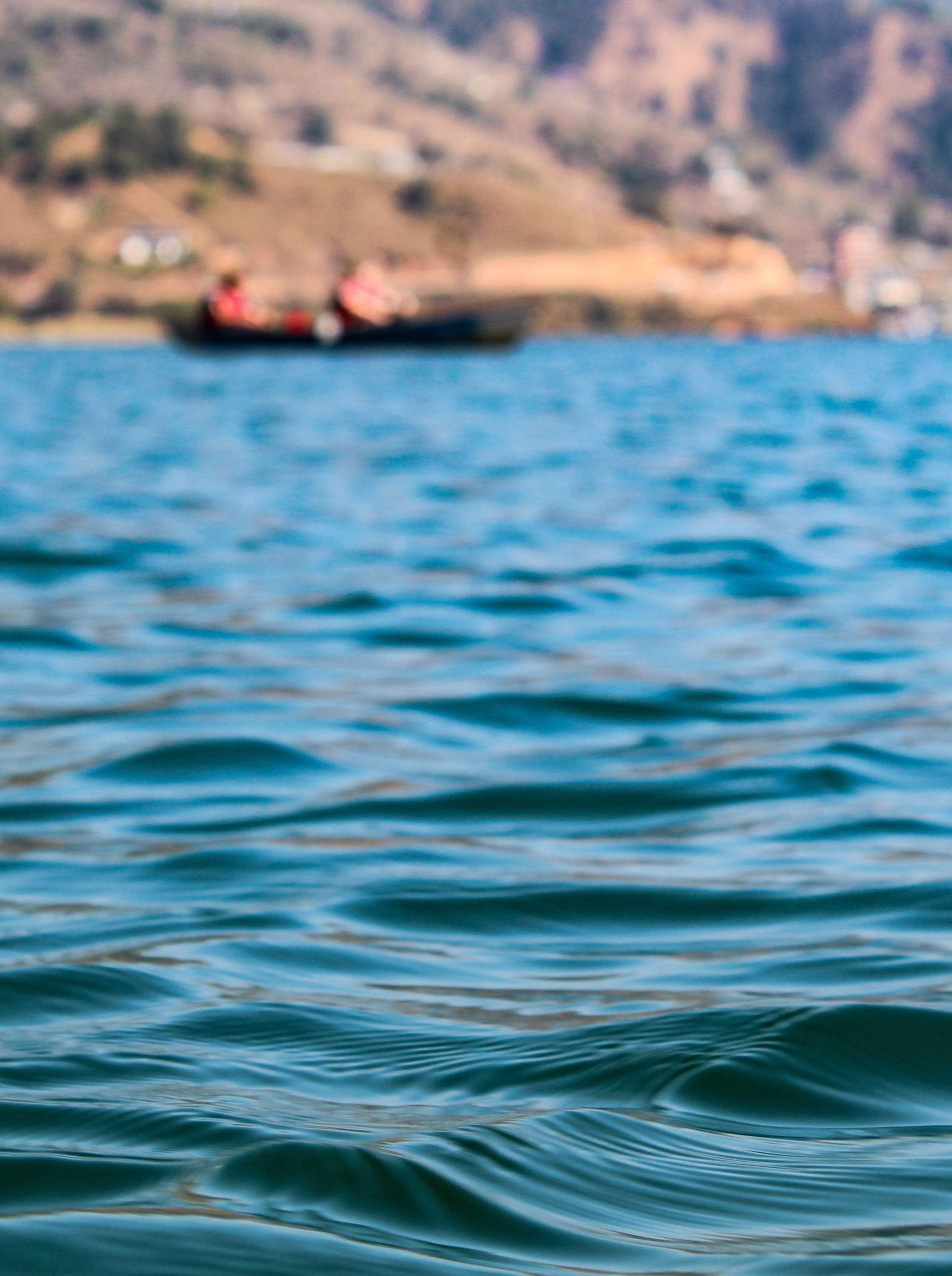 Free stock photo of blue water, boat, clear water, hillside