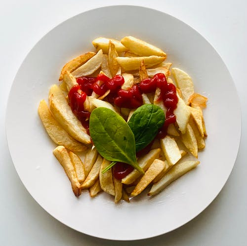 Fries with Ketchup Topped with Basil